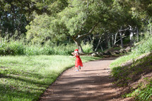 child walking on a path
