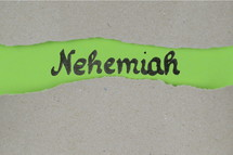 Nehemiah - torn open kraft paper over green paper with the name of the book Nehemia