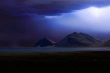 storm clouds over a mountain lake