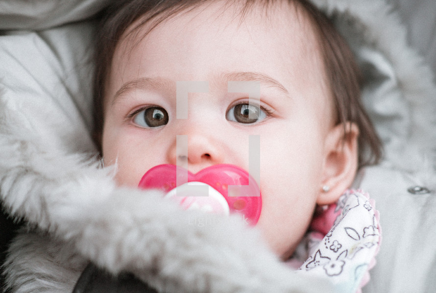 infant with a pacifier
