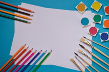 art supplies on a blue background