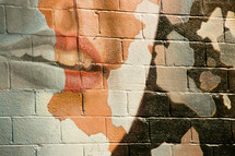 lips painting on a brick wall