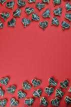borders out of home made heart shaped cookies with chocolate on red background