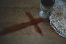 clay chalice and unleavened bread and blood stain cross
