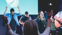 worship leaders singing on stage