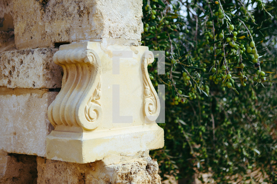 carved detail on a stone column