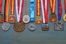 medals on cyan wooden background