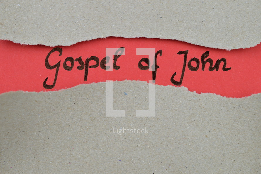Gospel of John - torn open kraft paper over light red paper with the name of the Gospel of John