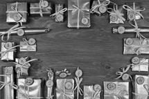 Frame of advent calendar with twenty four silver presents on grey wood