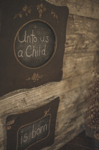 Unto us a child is born written on chalkboards