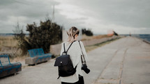 woman walking with a camera