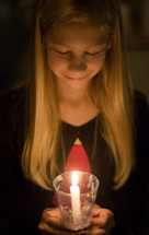 girl child at a Christmas Eve worship service