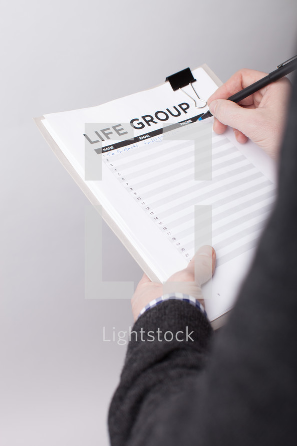 A man signing up to be in a life group