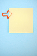 Empty post it notes with paperclips