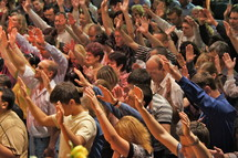 Hands raised to accept Christ.