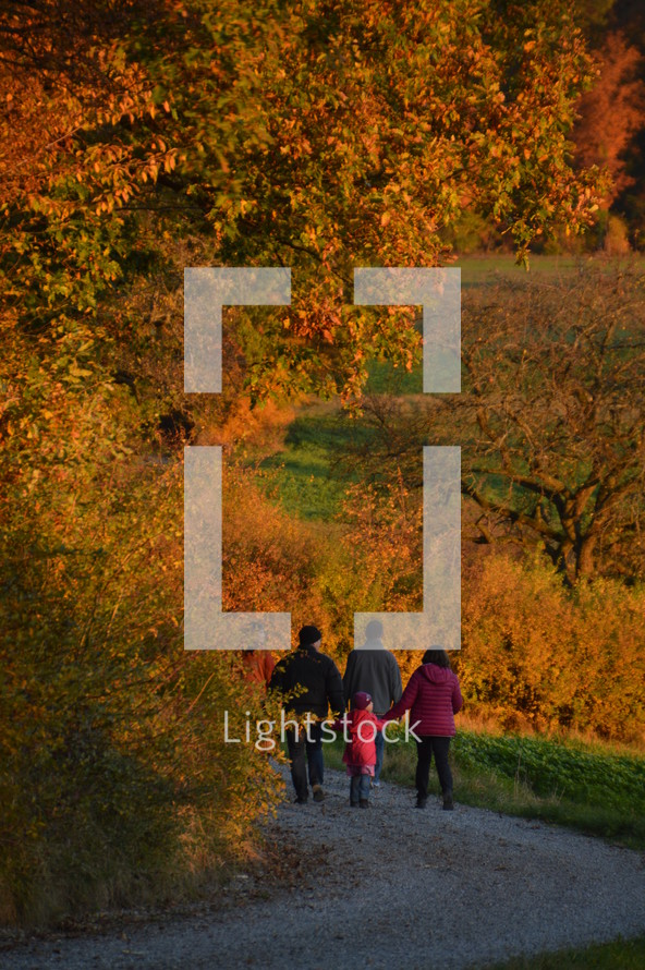 families walking on a path outdoors in autumn