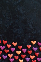 border of hearts on a black background