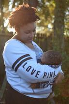 A mother cradling her infant son