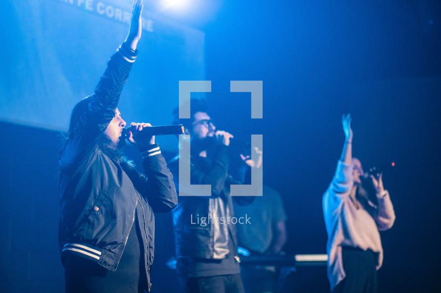 worship leaders singing on stage