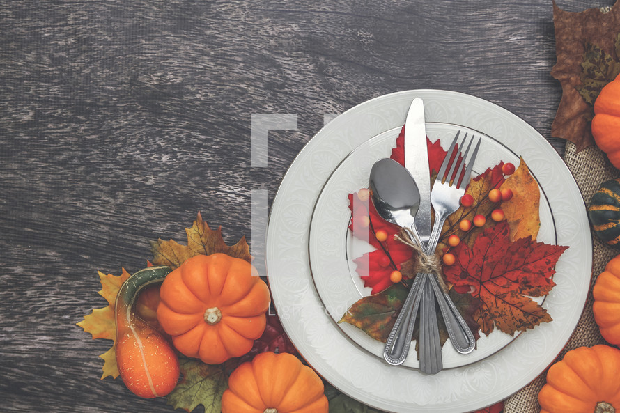 silverware on leaves on a plate fall dinner party place setting
