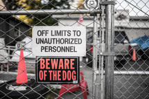 off limits to unauthorized personnel, beware of dog, sign