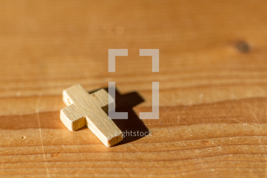 wooden cross on a table