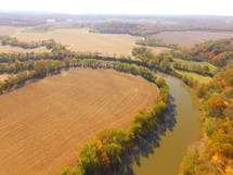 aerial view over a rural river in fall
