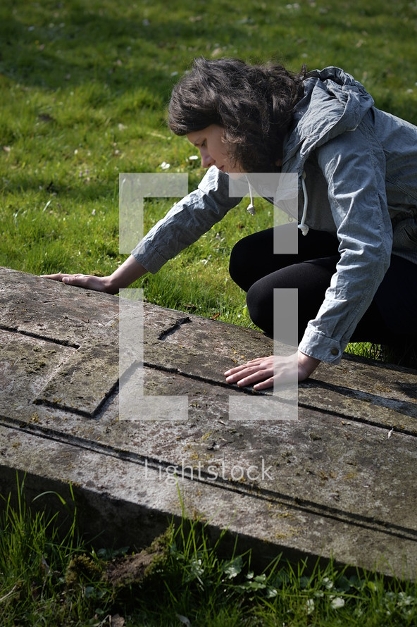grieving woman at a gravesite