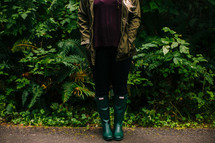 a woman wearing rain boots