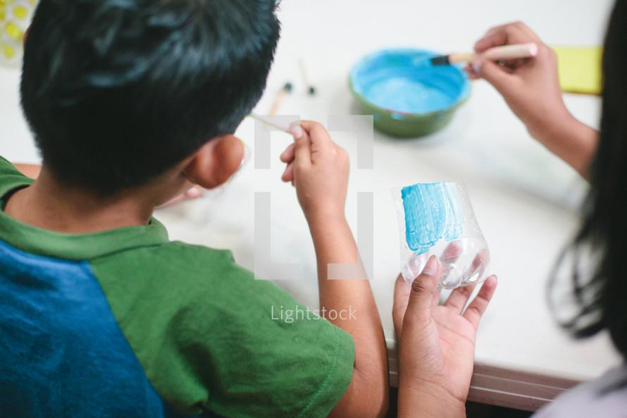 Children painting.