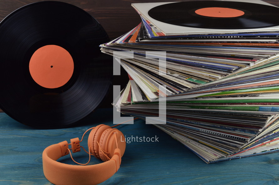 stack of vintage records and headphones