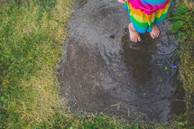 bare feet walking through a puddle