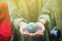person holding a globe in their hands