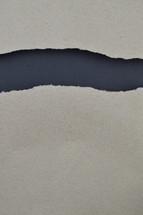 gray torn paper exposing black