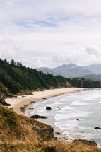 beach along a mountainous coastline