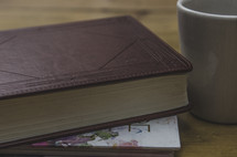 Bible, journal, and coffee mug on a table