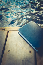 Bible on a dock