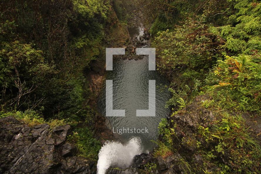 waterfall and swimming hole in Hawaii