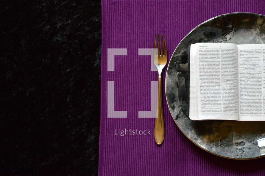 bible opened up at Matthew 4:4  on a plate, -  bible, bread, eat, word, hunger, Gods word, plate, fork, knife, silverware, eating, food, nourishment, daily, need, needing, feed, feeding, bible study, read, reading, Matthew, 4, open, purple, lilac, lent, fast, fasting, starving, sustenance, meal, everyday, focus, spare, give up, go without, cutlery, word, scripture, holy book, study, learn, learning, starve, live, life, quiet time, time, quiet, lenten, table