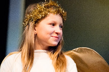 girl child dressed as a Christmas angel