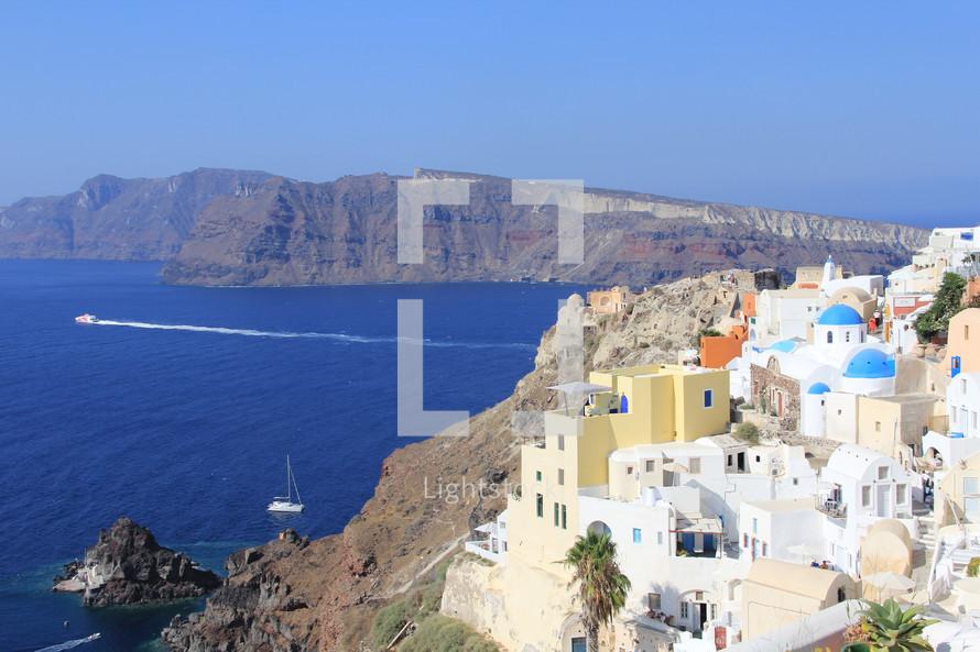 Colorful Greek village overlooking Mediterranean Ocean