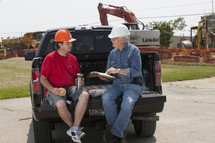 contractors planning in a truck bed