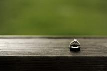 wedding ring sitting on wood table