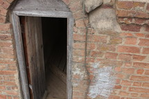 open door on a brick cellar