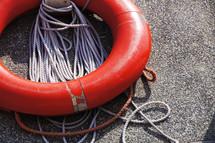 Life preserver, lifesaver or lifebuoy and securing rope