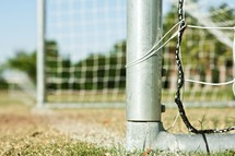 Close up of soccer goal in park.