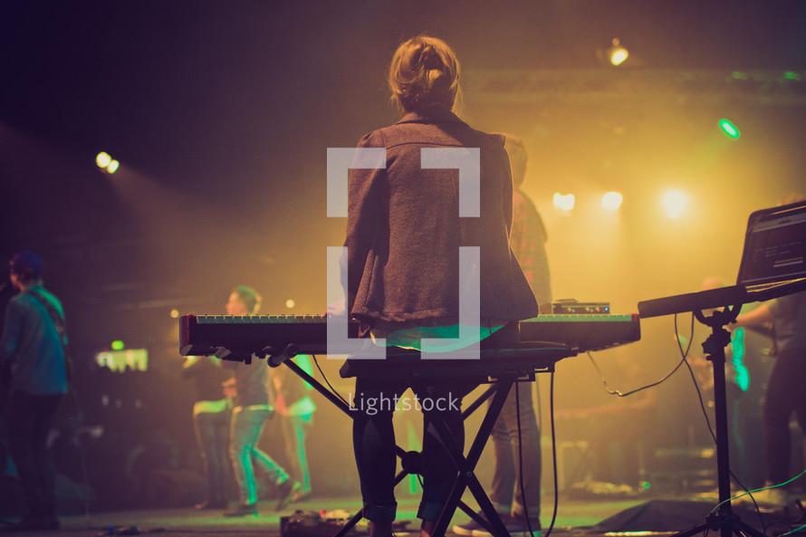 woman playing a keyboard at worship service