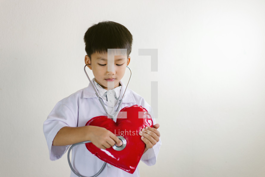 kid with a stethoscope and heart