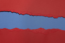 Blue beneath torn red paper.