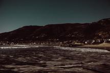tide washing onto a beach shore